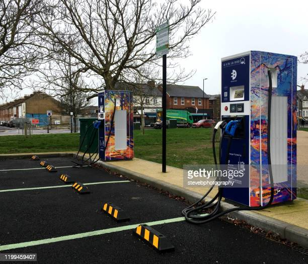 electric car charging pionts - stevebphotography stock pictures, royalty-free photos & images