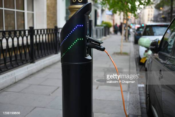 electric car charging point, london, uk - electric car stock pictures, royalty-free photos & images