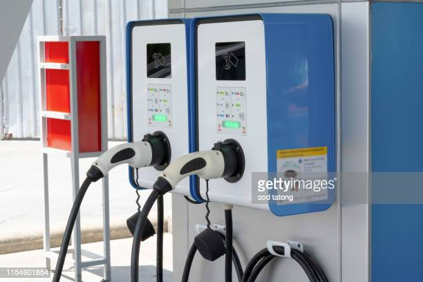 electric car charging station - alternative fuel vehicle stock pictures, royalty-free photos & images