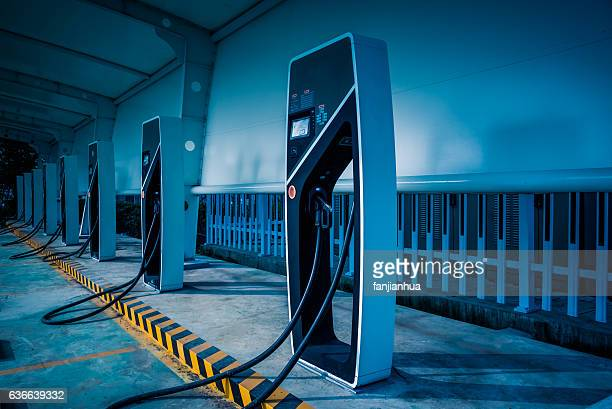 electric car charging station - alternative energy stock photos and pictures