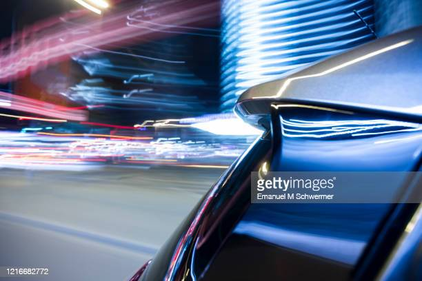 electric car drives fast in the city of berlin city while night. - verkehrswesen stock-fotos und bilder
