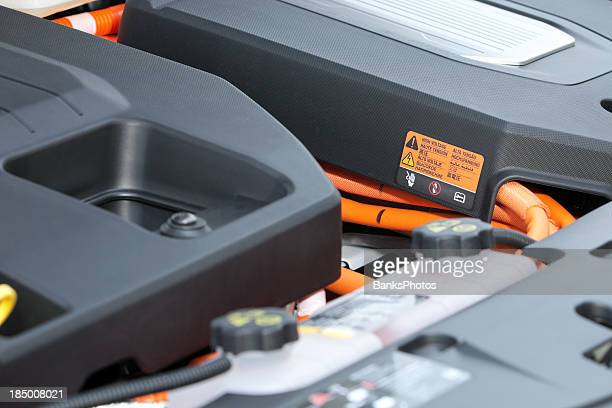 electric car engine compartment with high voltage sticker - hybrid vehicle stock pictures, royalty-free photos & images