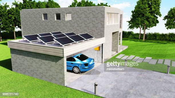 electric car gets battery charged with solar power while parked in garage - power supply stock pictures, royalty-free photos & images