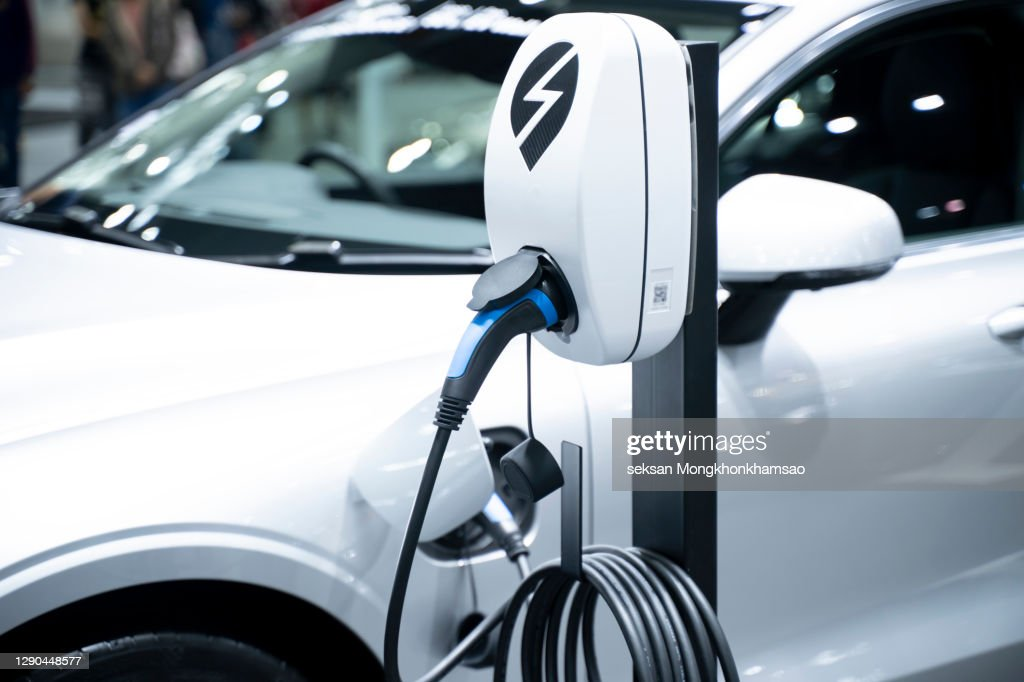Electric car in charging : Stock Photo
