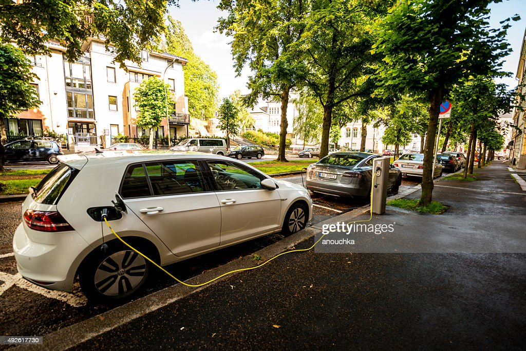 Electric car  is charging on Oslo street, Norway : Stock Photo