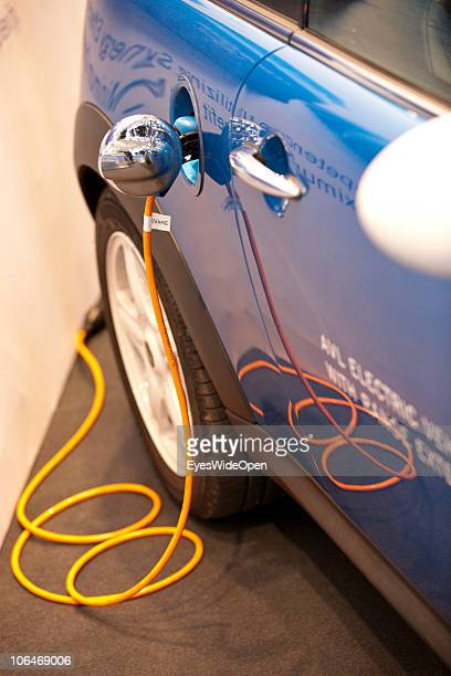 A electric car is recharged during the eCarTec 2010 the 2nd International trade fair for electric mobility at the New Munich Trade Fair Centre on...