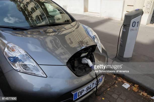 Electric car is recharging Renault in Paris France