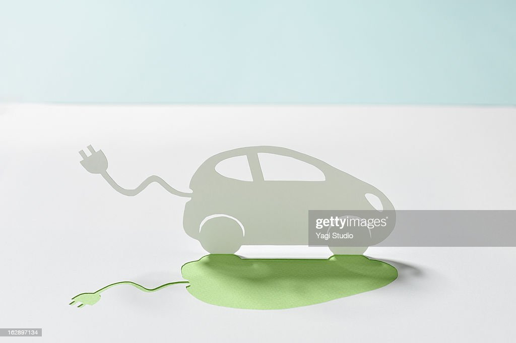 Electric car made ??of paper : Stock Photo