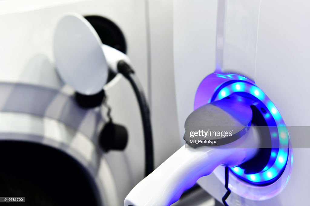 Electric car on charging : Stock Photo