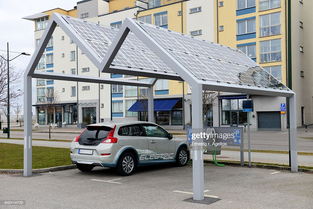Electric car on solar power station : Stock Photo