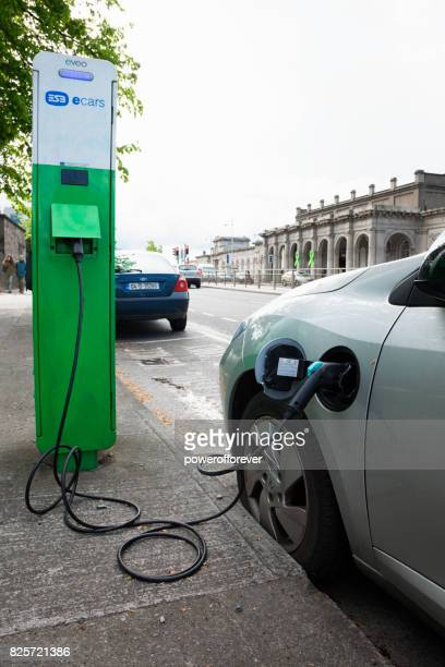 Electric car plugged in at an ecars charging station in Dublin, Ireland