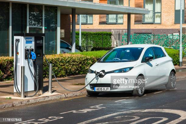 Electric car plugged into Evolt charge point in Cambridge England UK