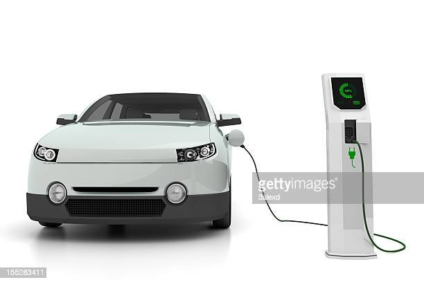 electric car plugged into the charging station - hybrid car stock photos and pictures