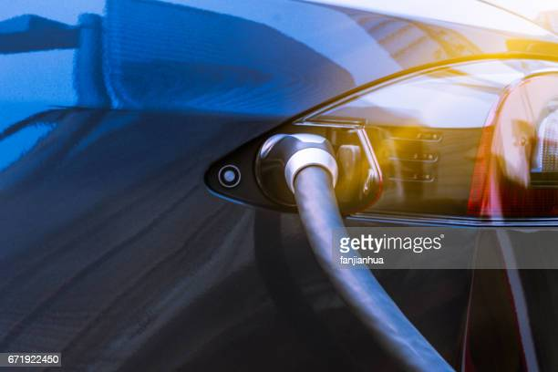 electric car recharging batteries - hybrid car stock photos and pictures