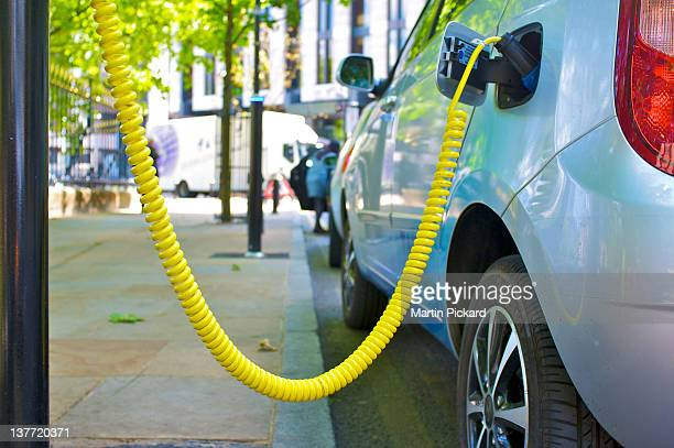 electric car street charging point - electric car stock pictures, royalty-free photos & images