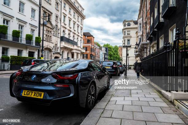 electric car, the bmw i8, is parked on an exclusive residential street in mayfair, london, uk - bmw i8 stock photos and pictures