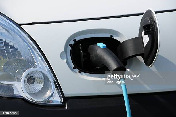 electric car, u.k. - electric vehicle charging station stock photos and pictures
