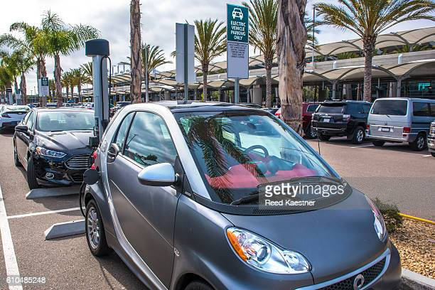 Electric cars charge at a charging station