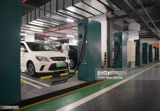 Electric cars charge at a charging station set up at the underground parking lot of Cadillac Arena on May 19, 2020 in Beijing, China.