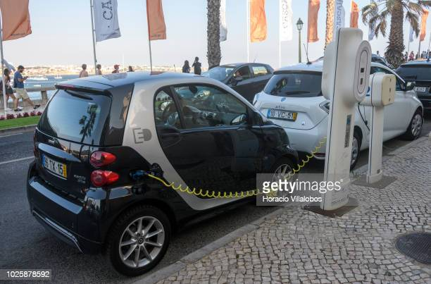 Electric cars charge batteries at a 'MOBI.E' charging post in Dom Carlos I avenue on August 24, 2018 in Cascais, Portugal. The largest EV-related...