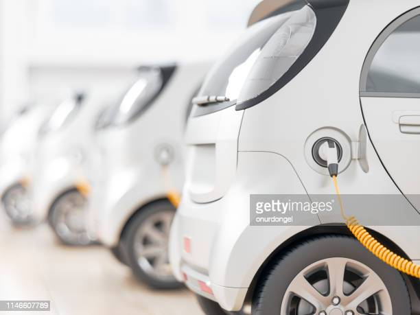 electric cars charging - alternative fuel vehicle stock pictures, royalty-free photos & images