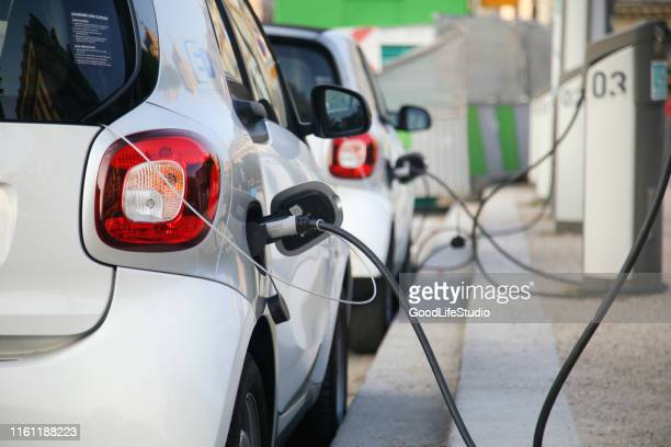 electric cars charging - electric vehicle stock pictures, royalty-free photos & images