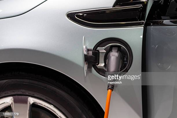 electric car/vehicle recharging - hybrid vehicle stock photos and pictures
