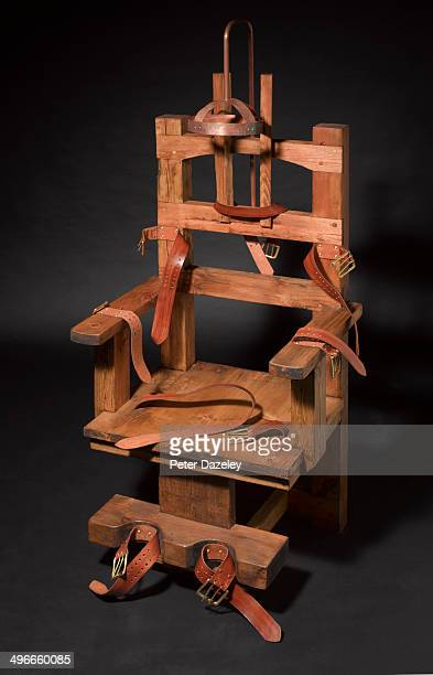 electric chair on black background - electric chair stock photos and pictures
