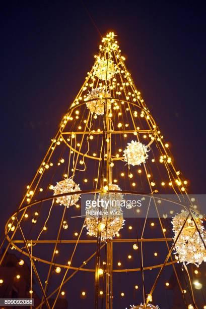 Electric Christmas tree against black sky