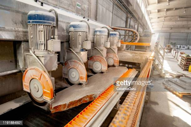 electric circular saws slicing marble into tiles in factory - industrial equipment stock pictures, royalty-free photos & images