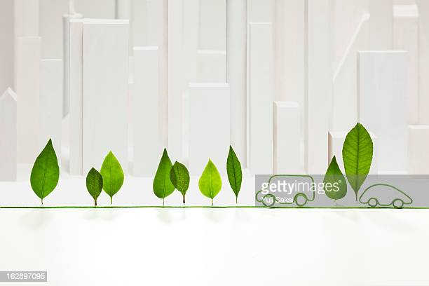 electric cord  with standing leaves  in front of w - hybrid car stock photos and pictures