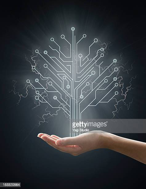 Electric energy sparks from a hand ,form of  tree