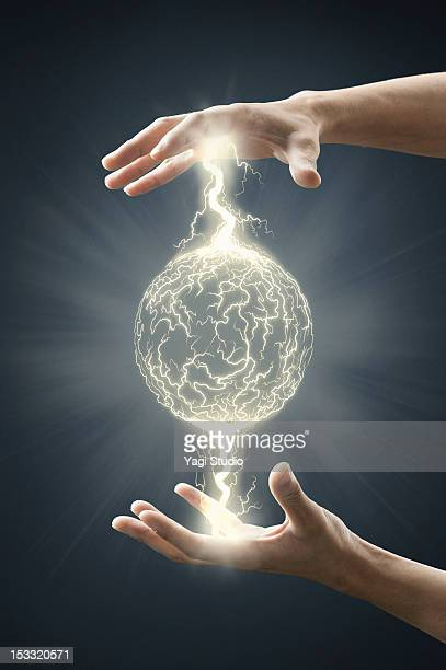 electric energy sparks from a hand - control stock pictures, royalty-free photos & images