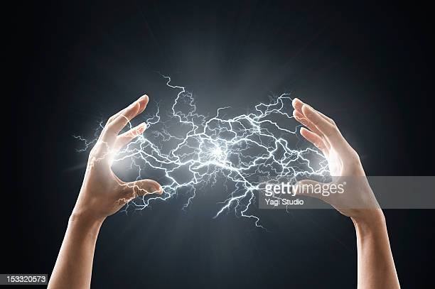 electric energy sparks from a hand - strom stock-fotos und bilder