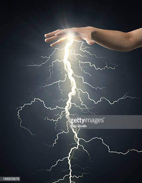 electric energy sparks from a hand - god stock pictures, royalty-free photos & images