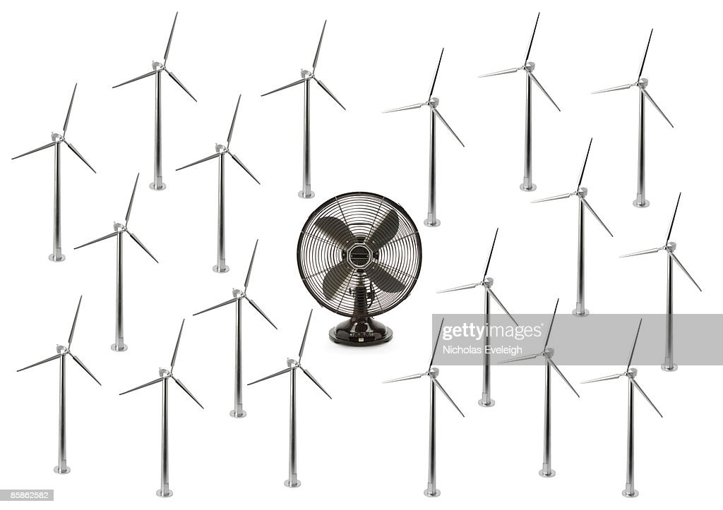 Electric fan and many wind turbines : Stock-Foto