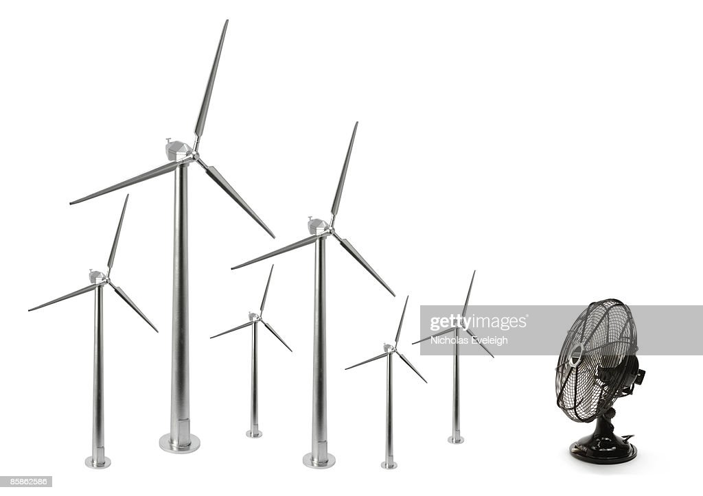 Electric fan and six wind turbines : Stock-Foto