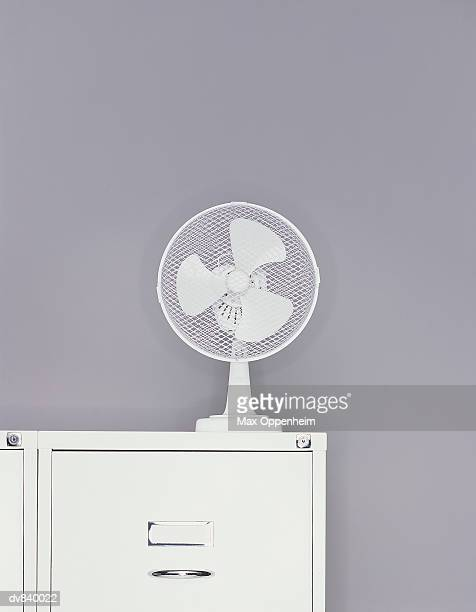 Electric Fan On Top Of Filing Cabinet