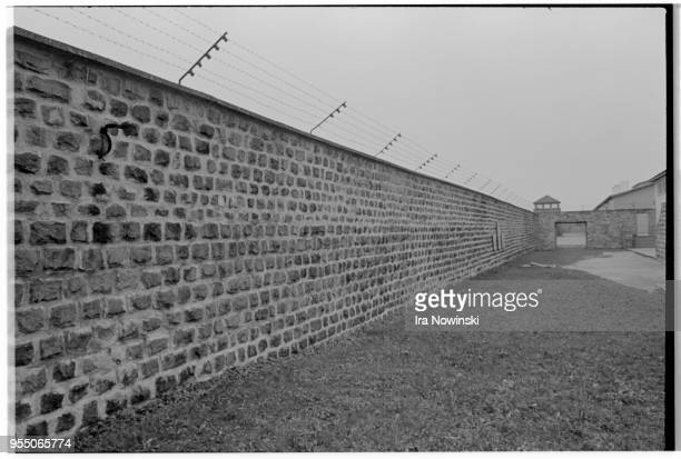 Electric fence and courtyard A brick electric fence surrounds the execution courtyard at Mauthausen a Nazi concentration camp in operation during...