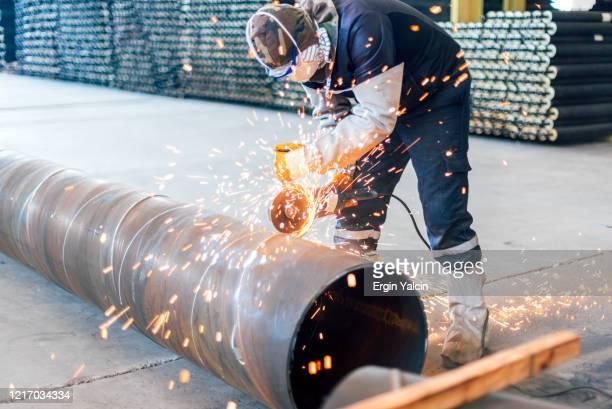 moedor elétrico na fábrica - indústria metalúrgica - fotografias e filmes do acervo