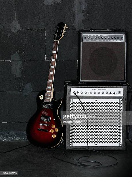 electric guitar and amplifier - electric guitar stock pictures, royalty-free photos & images