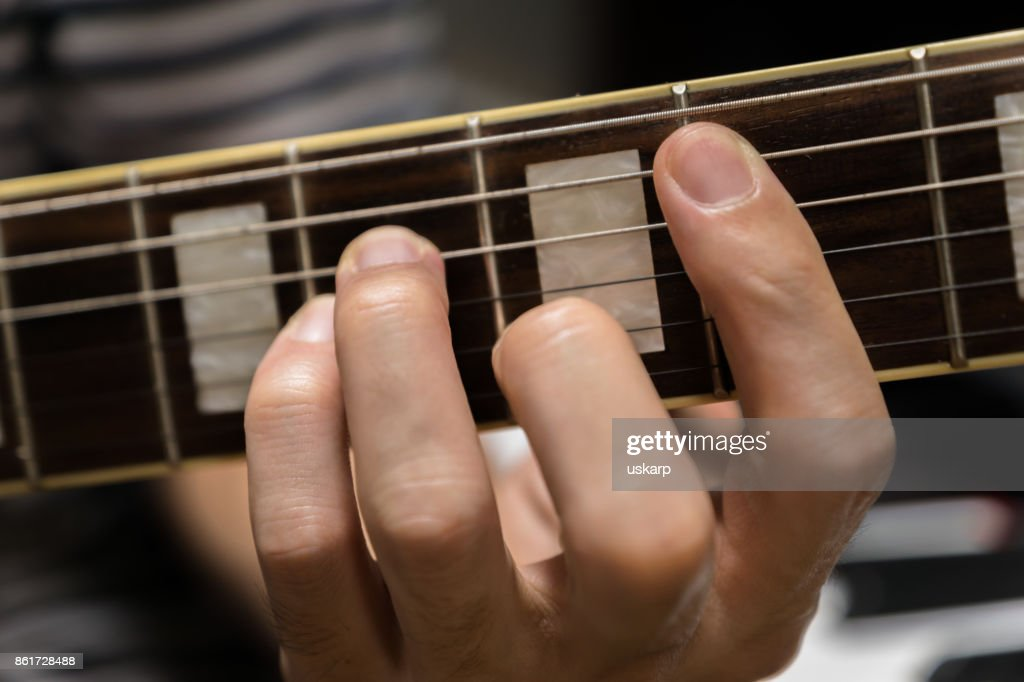 Electric Guitar Playing Chord Stock Photo Getty Images