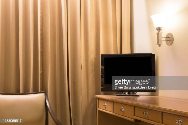 electric lamp on wall at home - flat screen stock pictures, royalty-free photos & images