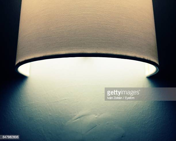 electric lamp on wall at home - iván zoltán stock pictures, royalty-free photos & images