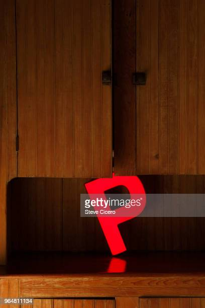 electric letter p displayed in wooden counter - letter p stock pictures, royalty-free photos & images