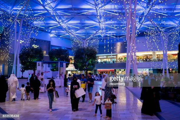 Electric lights illuminate shoppers in Avenues shopping mall in Kuwait City Kuwait on Sunday Aug 13 2017 Kuwait will issue a tender to build the...