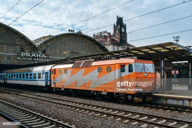 Electric locomotive with passenger train at Prague Main Station