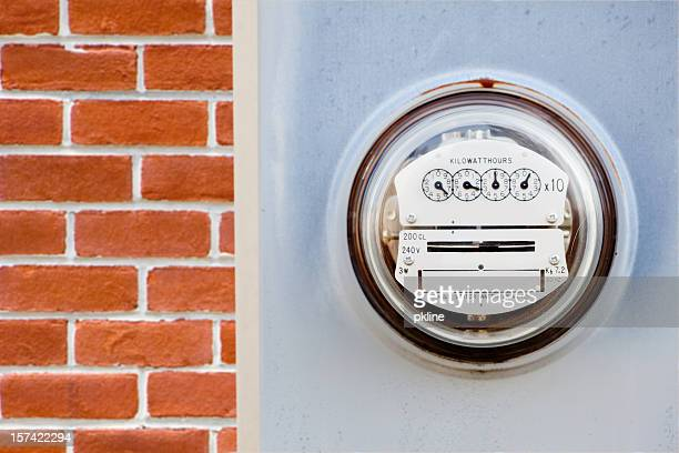 electric meter on house - kilowatt stock pictures, royalty-free photos & images