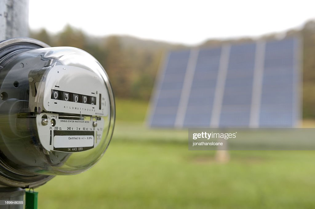 Electric meter with solar panel : Stock Photo