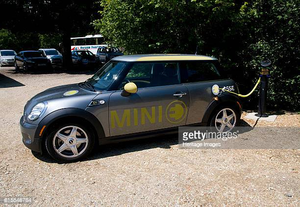 Electric Mini at battery charging point 2011 Artist Unknown